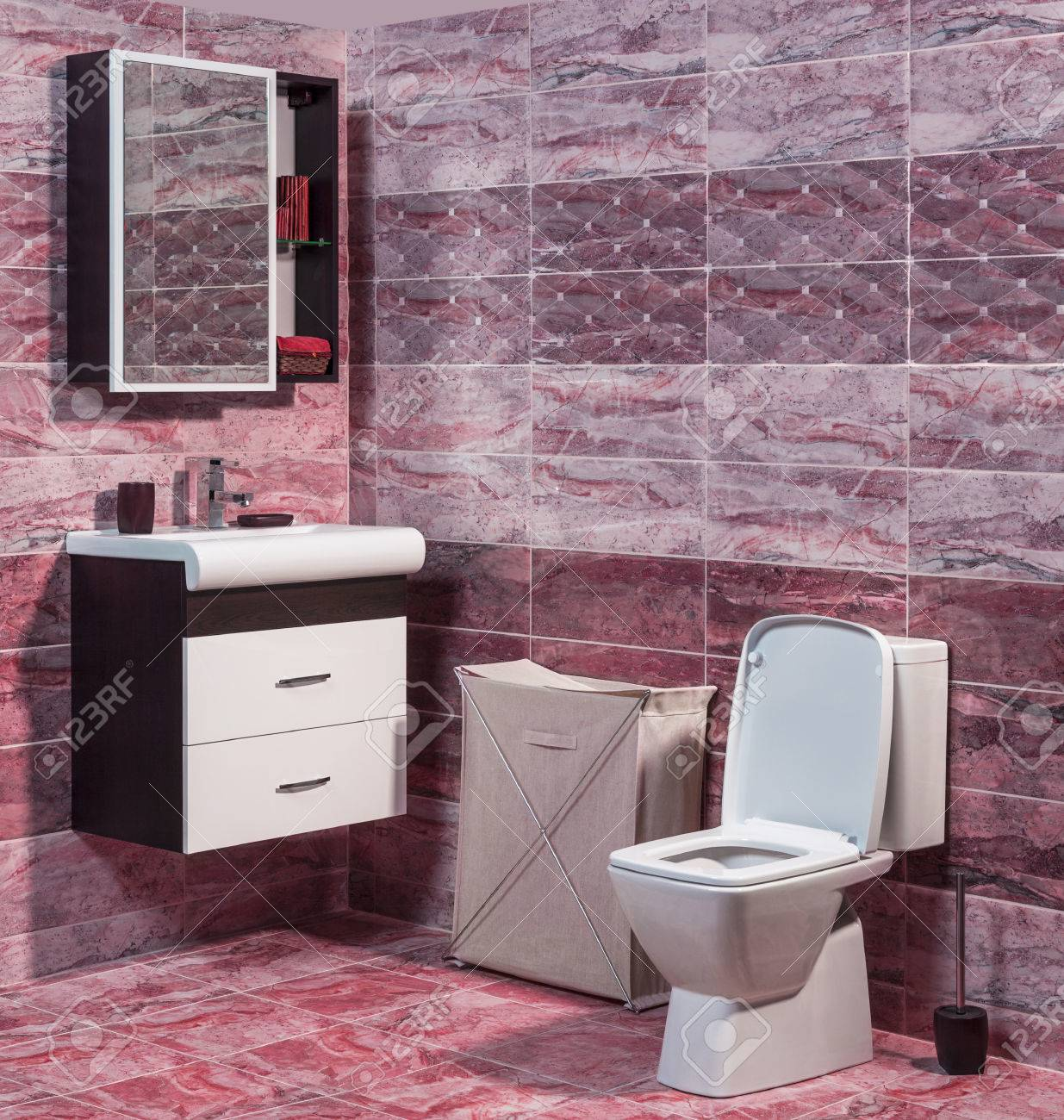 Inside Of Fashionable Bathroom   Toilet And Sink And Modern Ceramic Tiles  In Red Color Stock