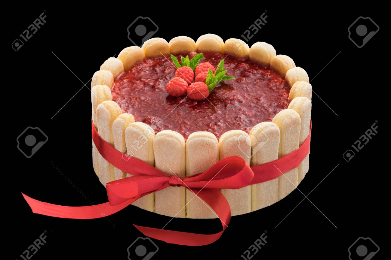 Festive Raspberry Cake With Biscuits And A Red Ribbon Stock Photo