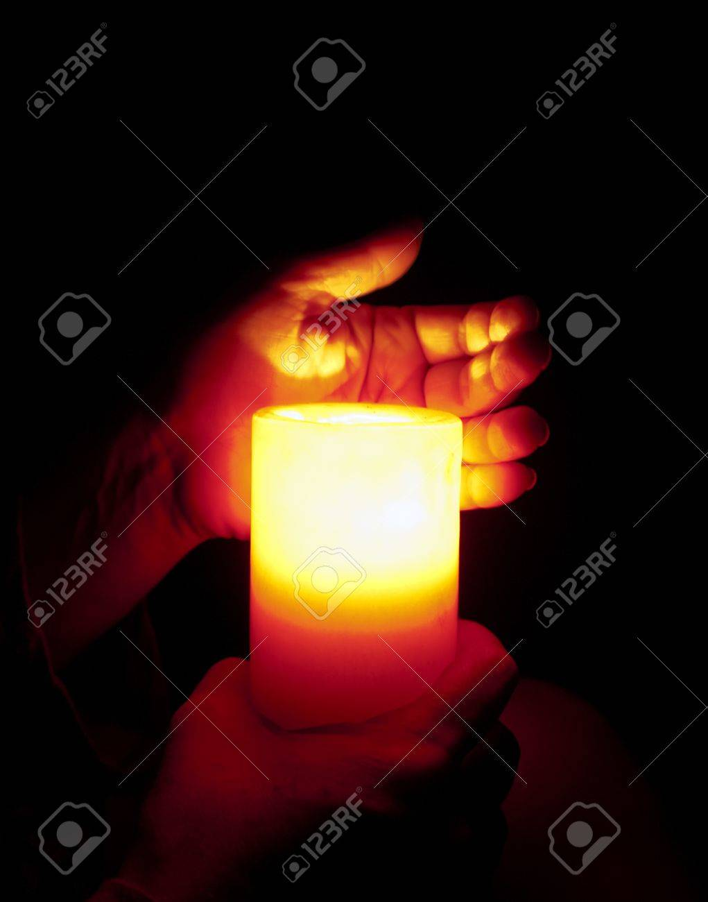 Hands Holding Burning Candle In The Dark Stock Photo, Picture And ... for Holding Candle In The Dark  181obs