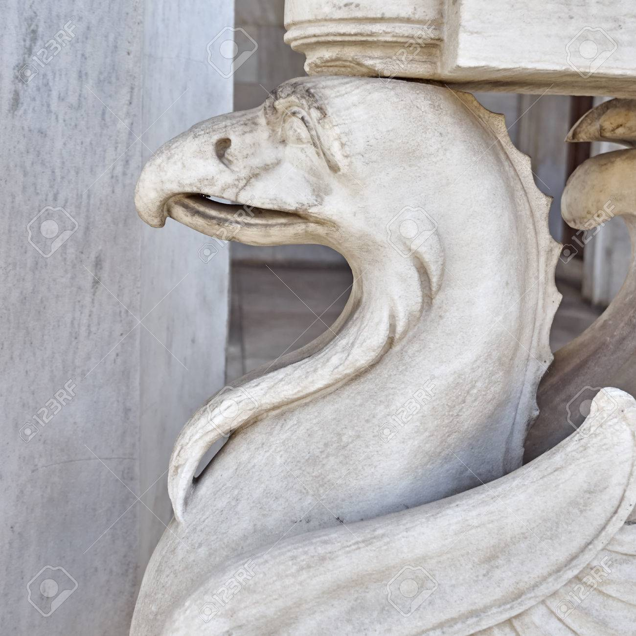 griffin mythical creature marble statue closeup stock photo