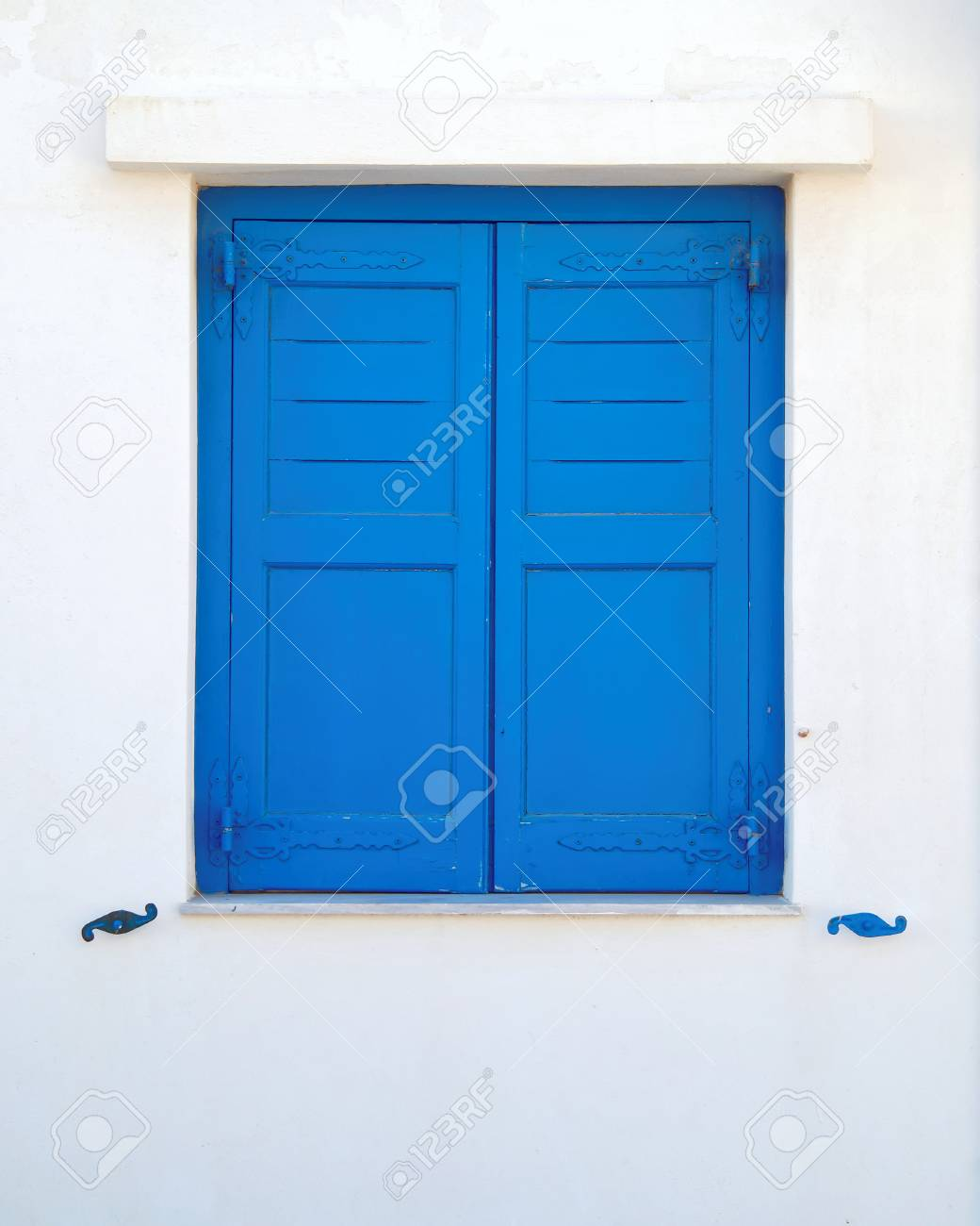 Greece Blue Painted Wooden Window Shutters On White Wall