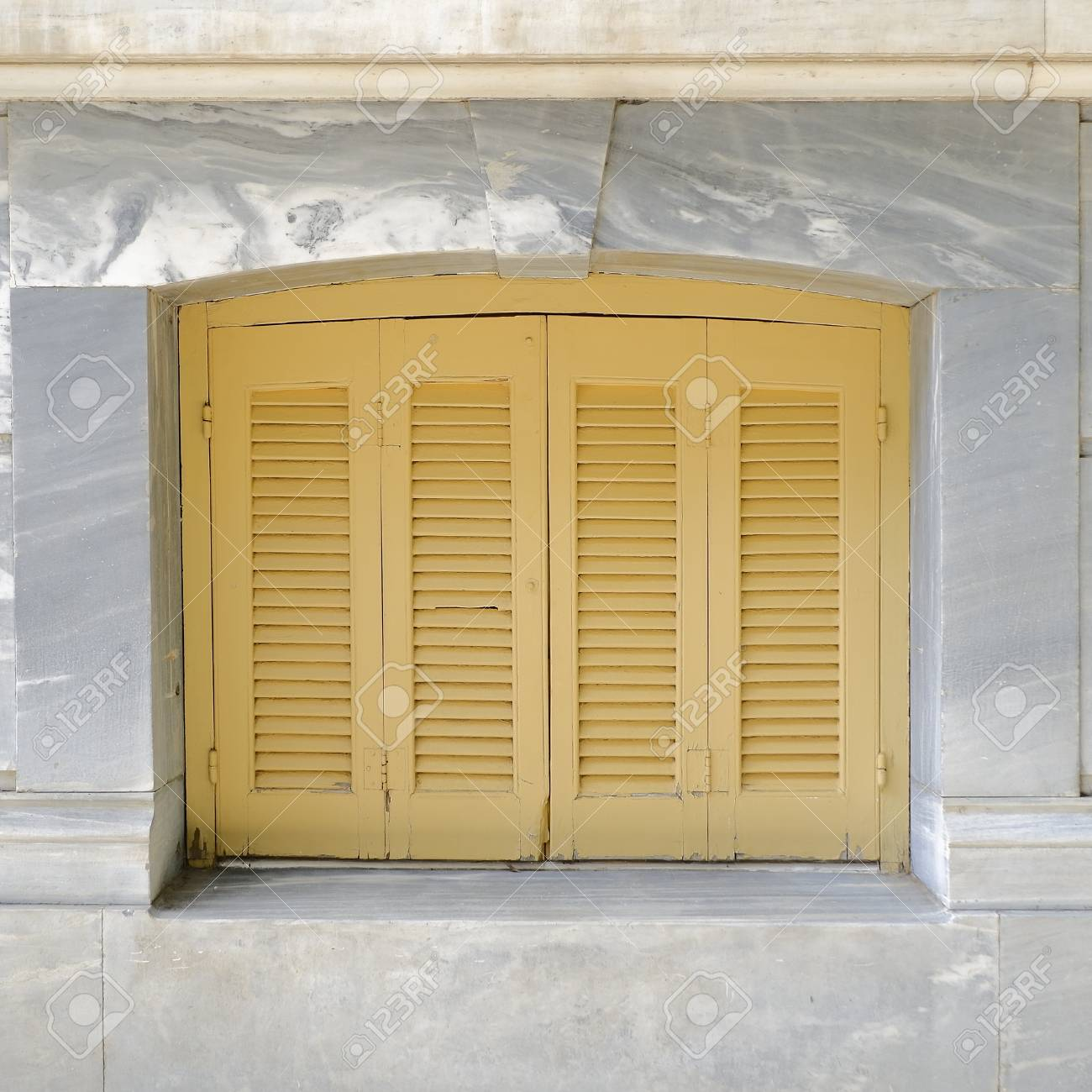 Pale Orange French Style Window Shutters Closeup