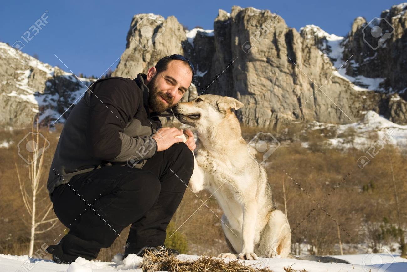 Man with dog in winter forest Stock Photo - 8947800