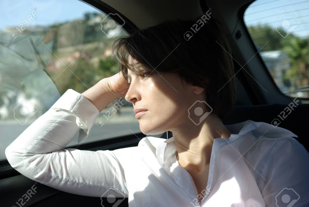 Woman at back seat of car looking out window Stock Photo - 9492929