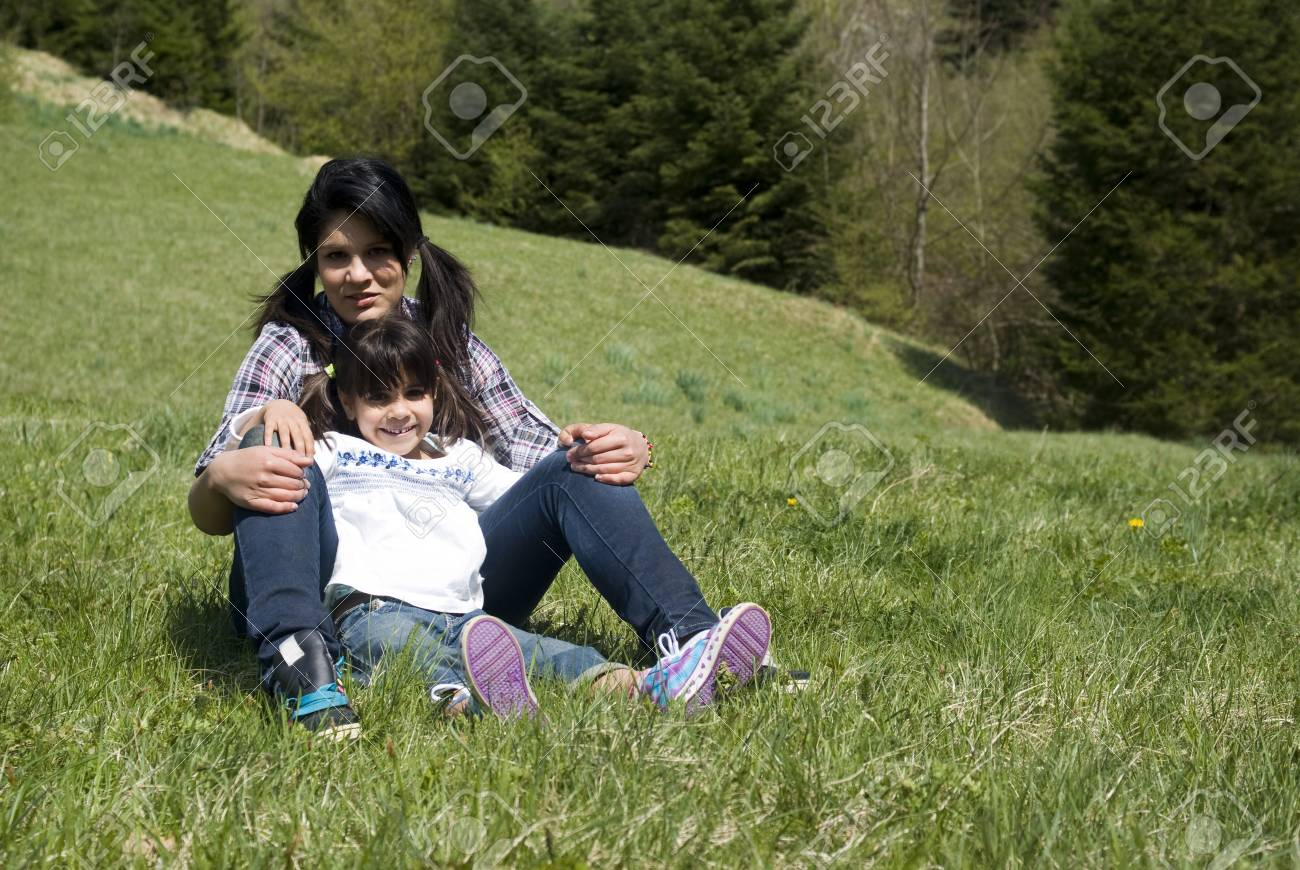 Happy sisters lying in grass Stock Photo - 10253443