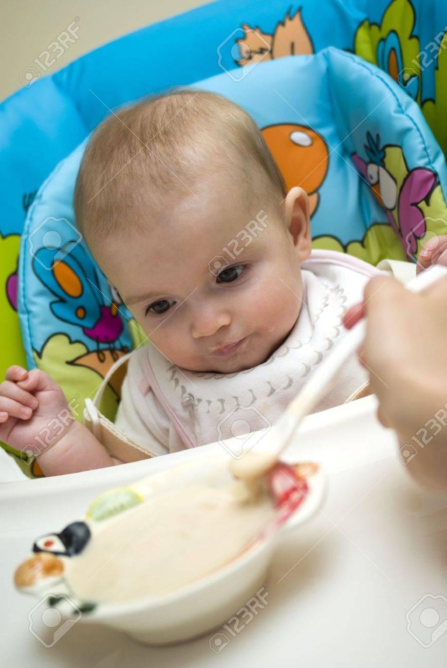 Mother feeding caucasian baby Stock Photo - 17851485