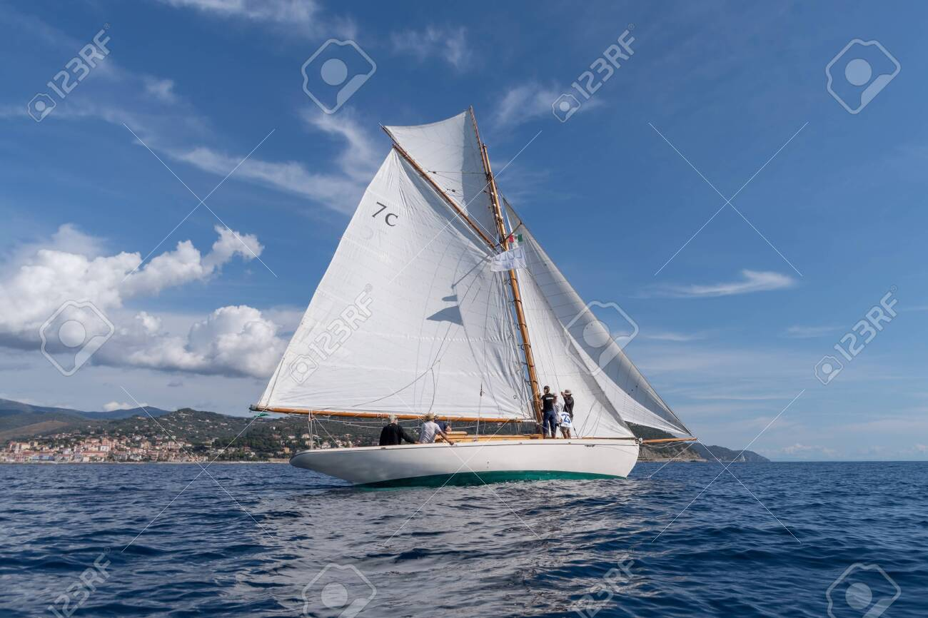 Imperia, Italy - September 7, 2019: Lulu sail yacht, built in 1897, is the oldest French classic yacht, during regatta in Gulf of Imperia. Established in 1986, the Imperia Vintage Yacht Challenge Stage is a of the most important event in sailing the Medit - 133857742
