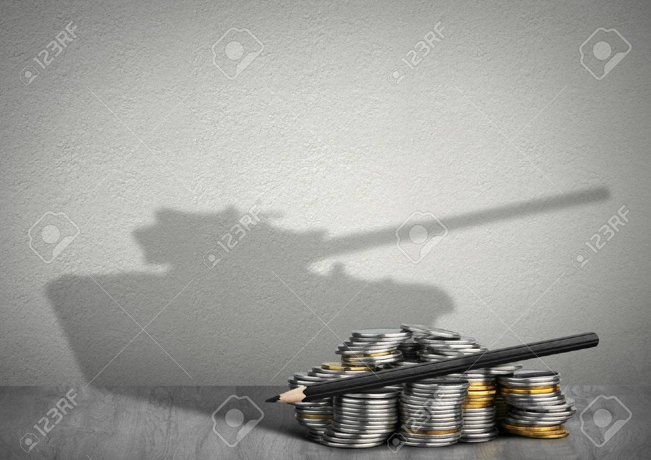 financing war concept, money with tank shadow - 55015762