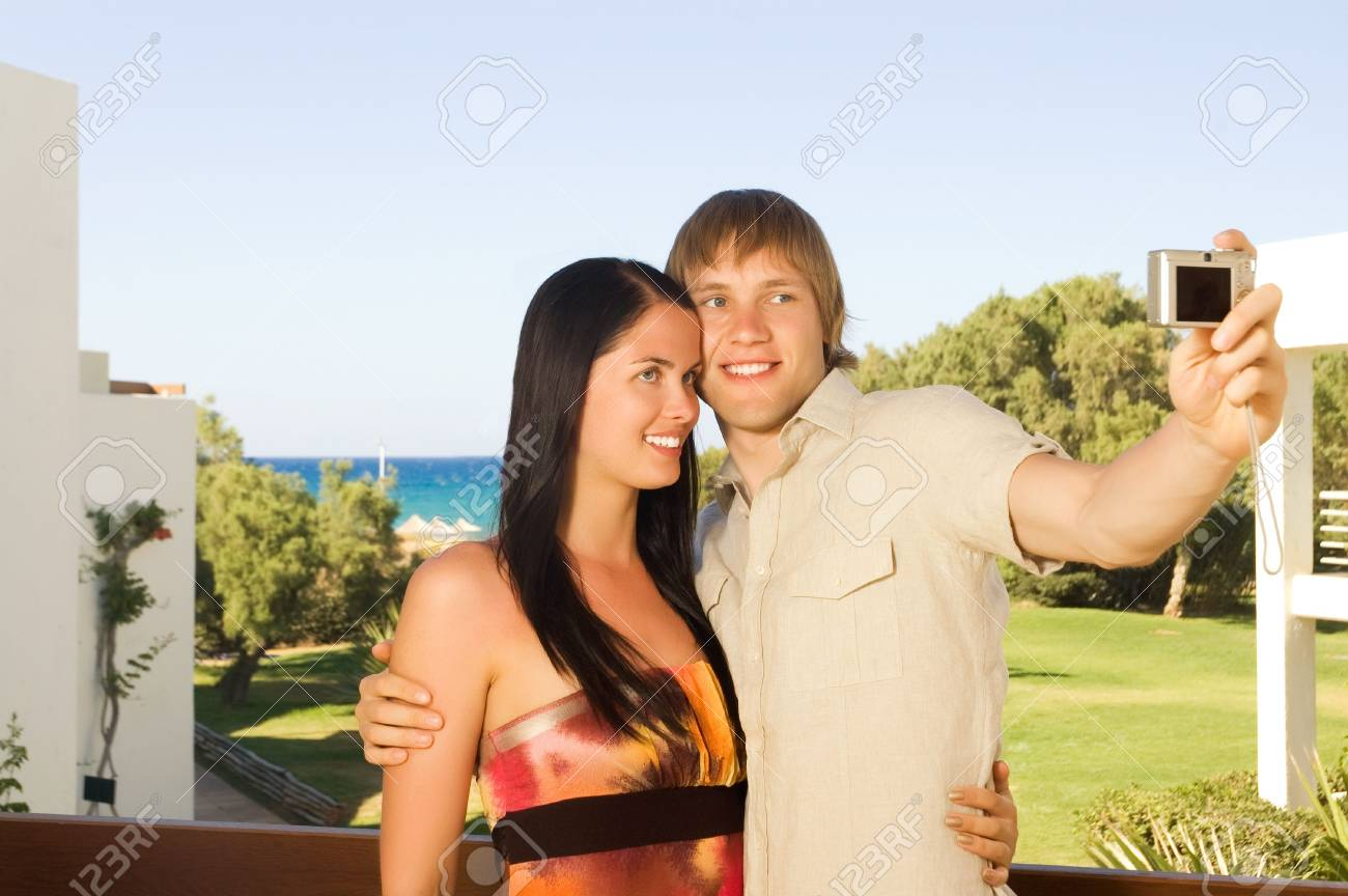 Young couple taking a photo of themselves Stock Photo - 4209751