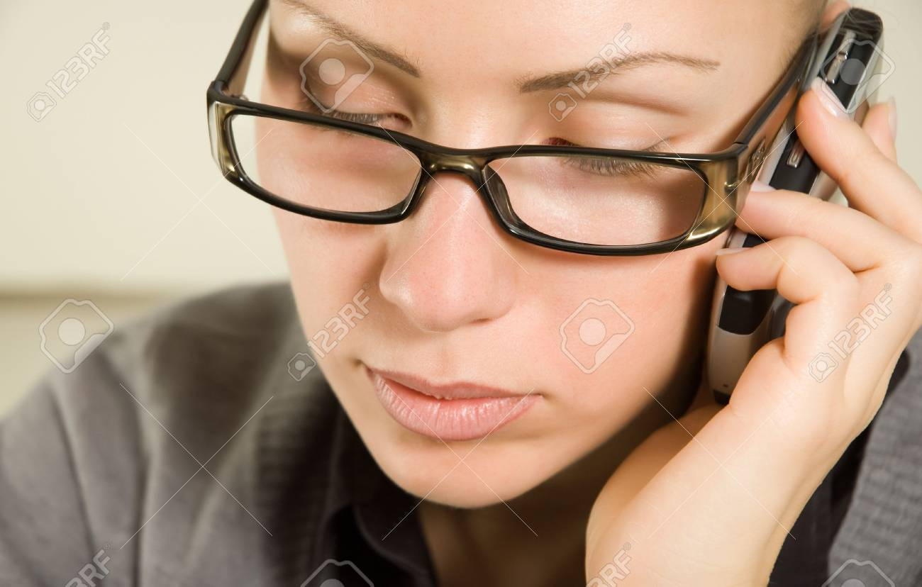 Young beautiful woman talking by phone Stock Photo - 5028439