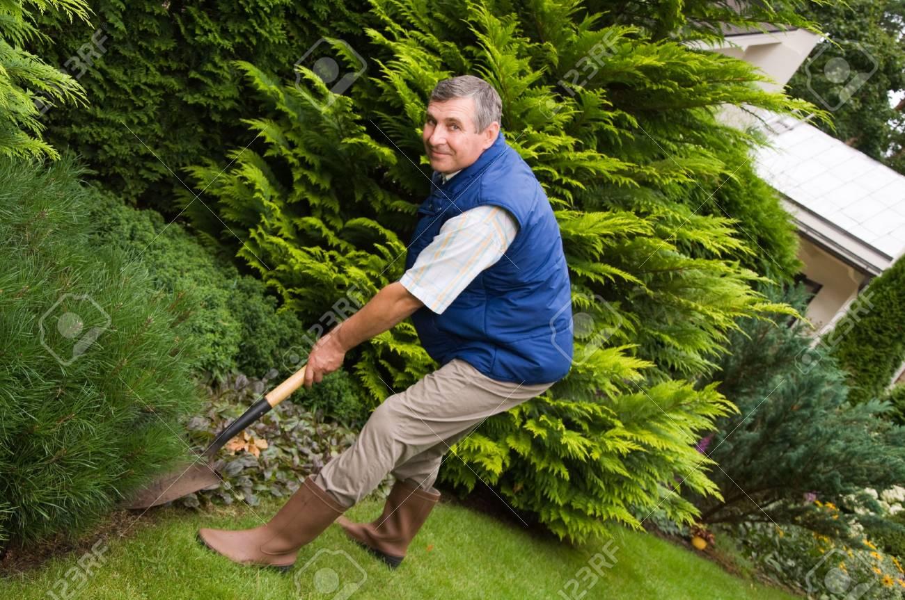 Man working in the garden Stock Photo - 6807157