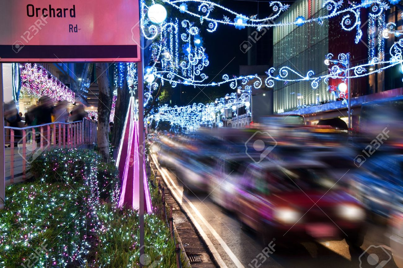 Orchard Road, Singapore. The street and buildings with lights and decorative items in preparation for Christmas. motion blurred Stock Photo - 12461667