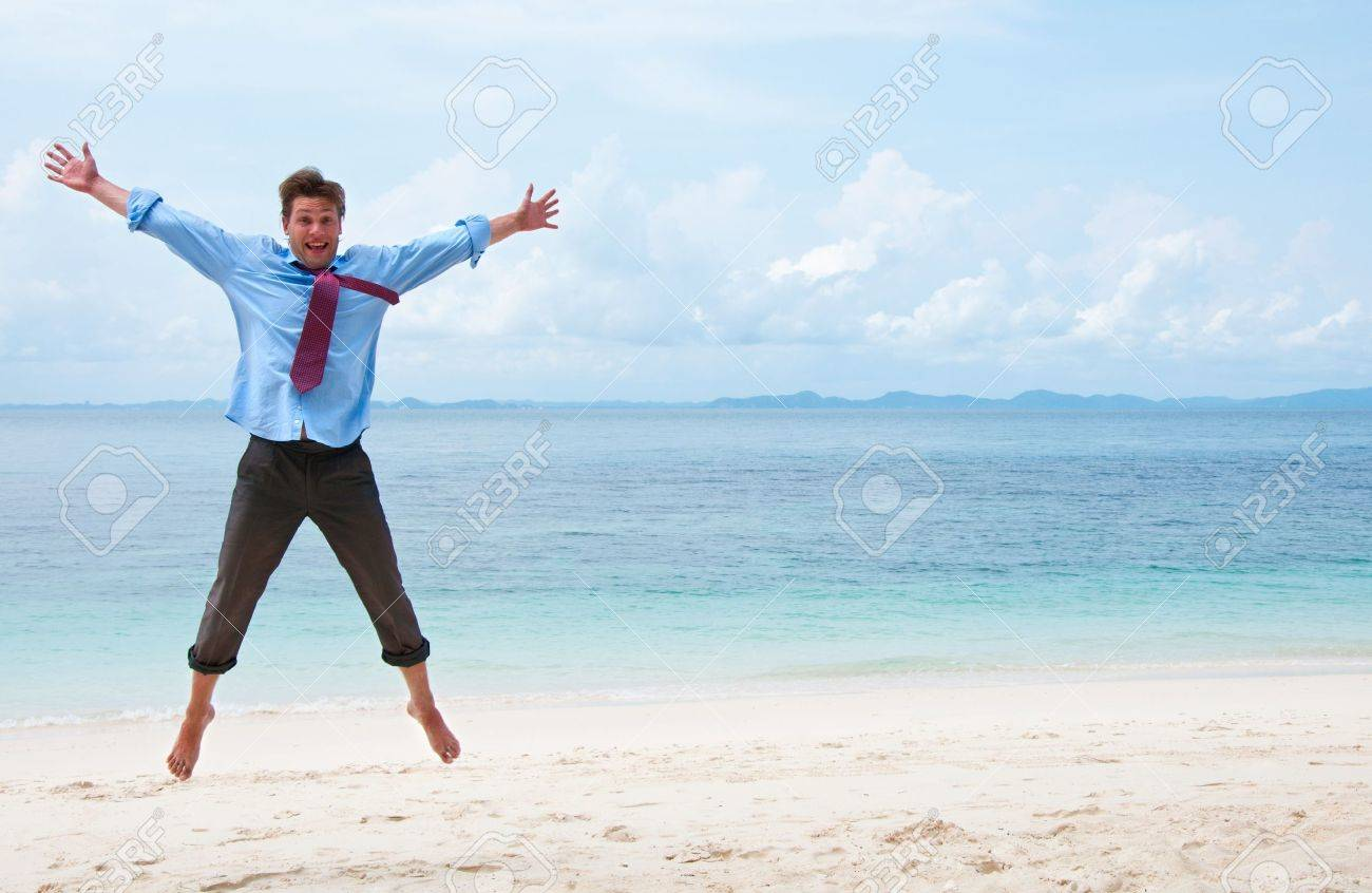 Funny business man jumping on the beach Stock Photo - 12779947
