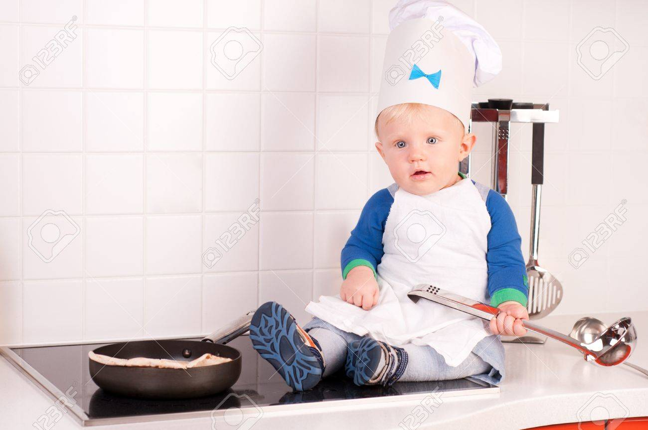 Little baby chef in the cook hat with metal ladle Stock Photo - 15654151 8294a92601fd