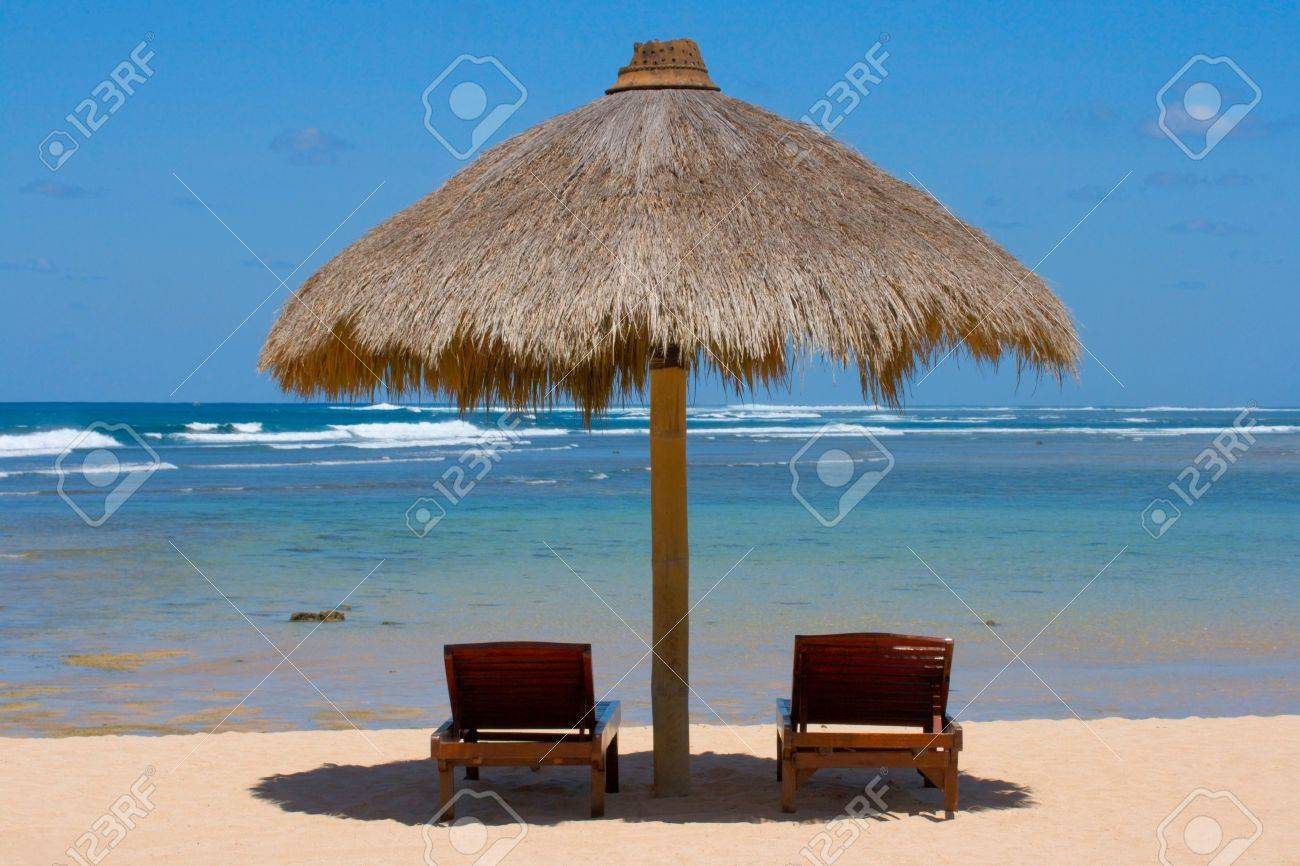 Two wooden lounge chairs under tent on beach Stock Photo - 2955106