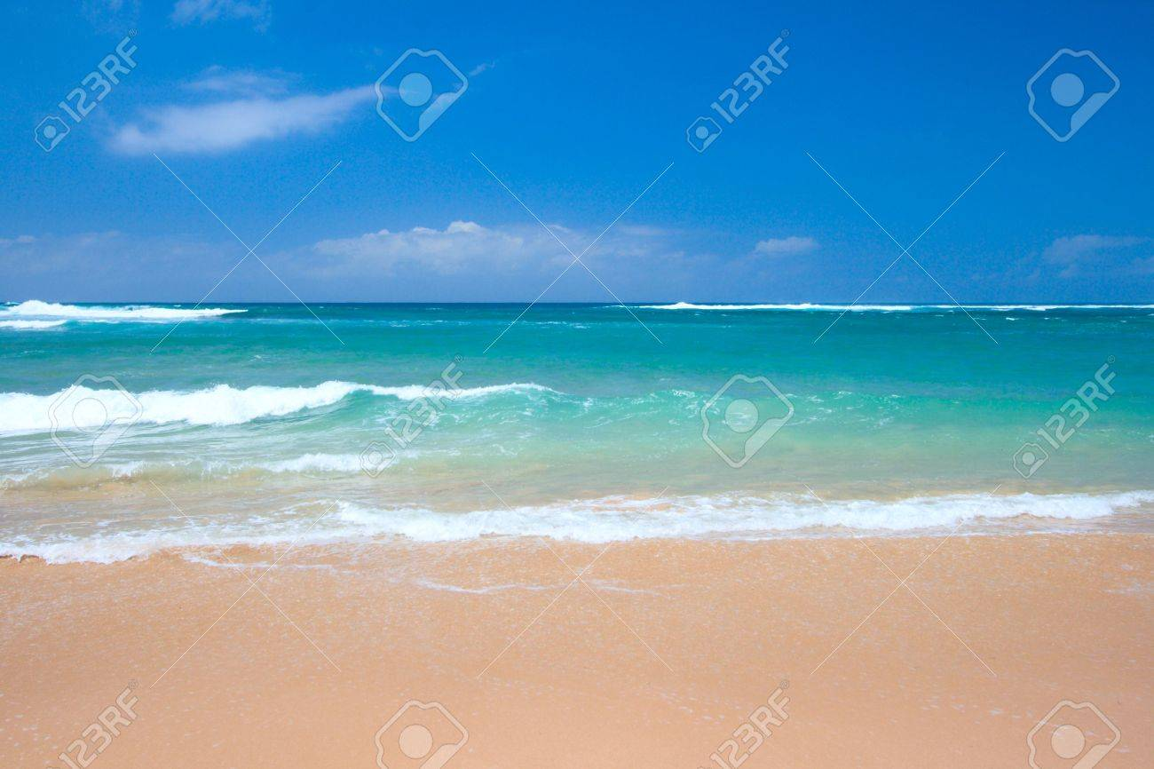 Peaceful Beach Scene With Ocean And Blue Sky Stock Photo Picture
