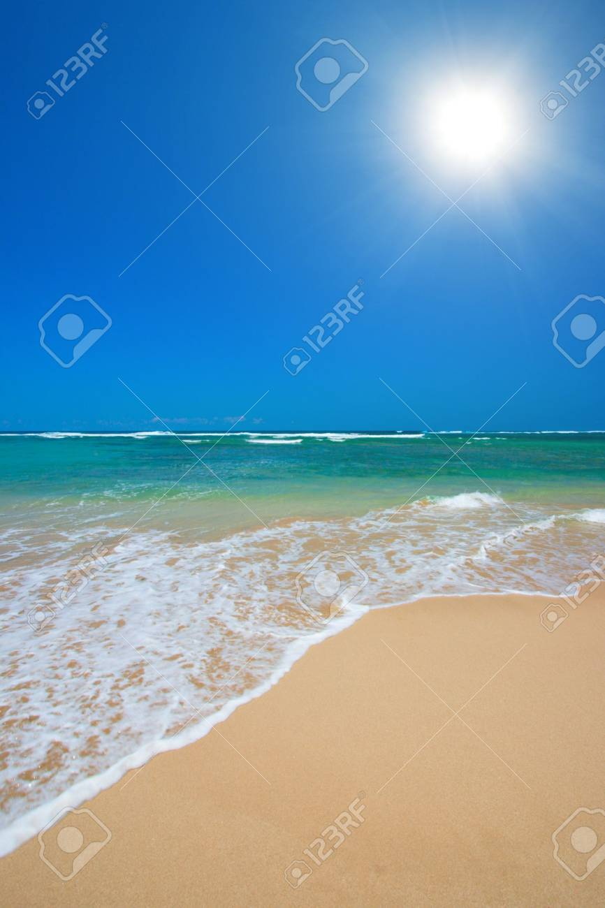 Wave surging on sand on peaceful beach Stock Photo - 3080193