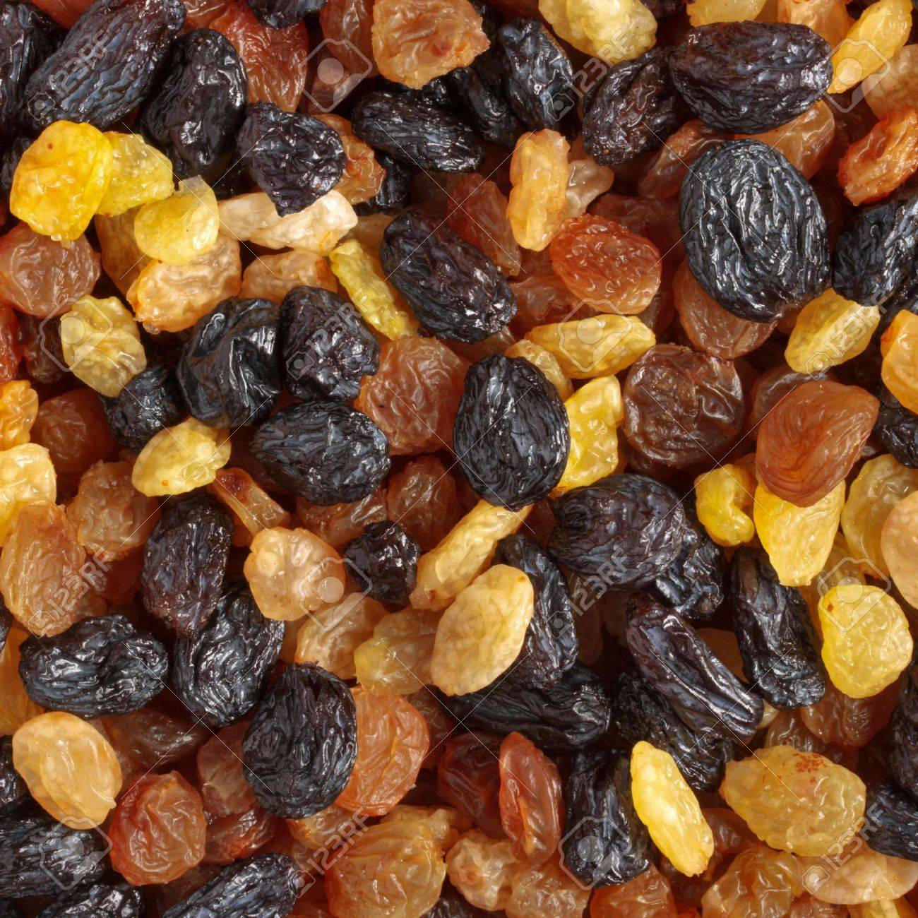 Mixed raisins of different colors close up Stock Photo - 4507731