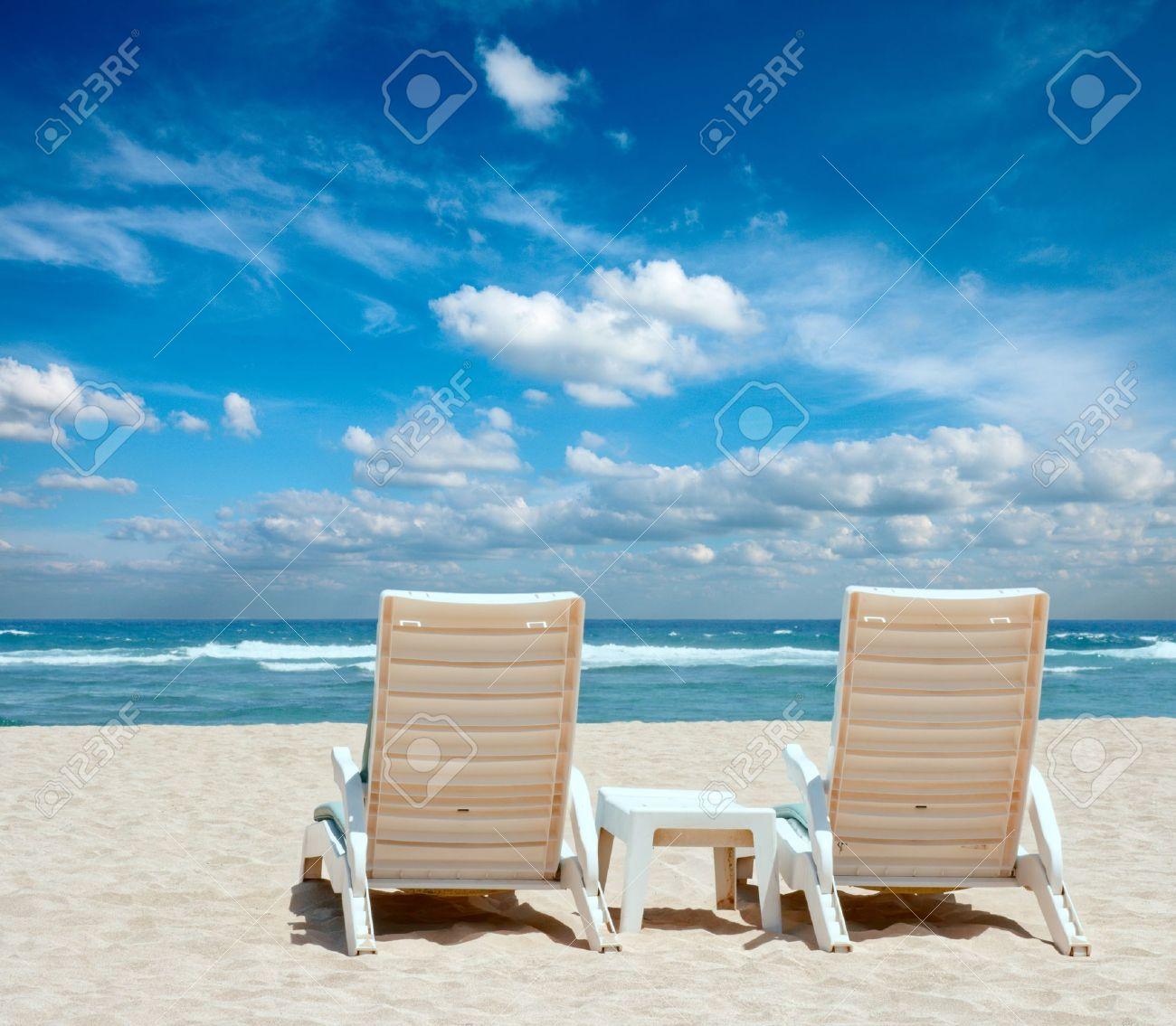 Beach with chairs - Beach Chairs Two Sun Beach Chairs On Shore Near Ocean Stock Photo