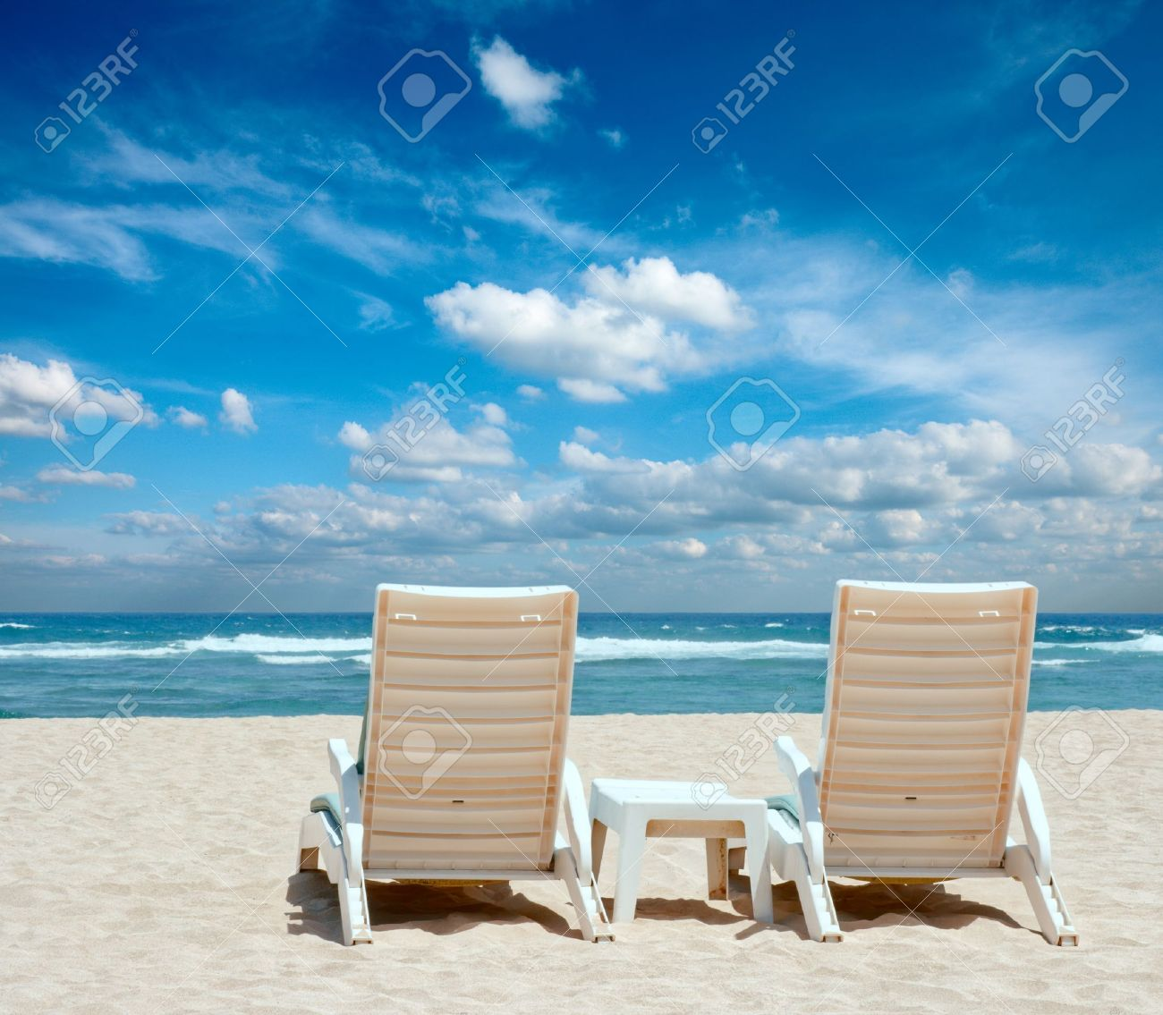 Stock Photo - Two sun beach chairs on shore near ocean & Two Sun Beach Chairs On Shore Near Ocean Stock Photo Picture And ...