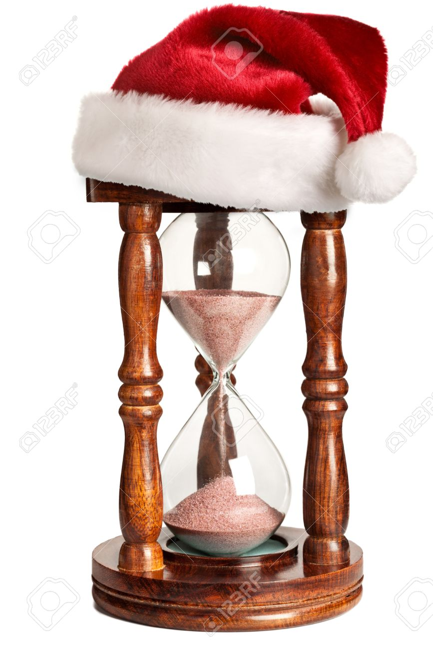 Christmas is coming concept - hourglass  with Santa Claus hat isolated on white background Stock Photo - 10745934