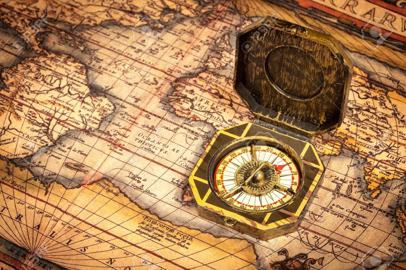Pirate World Map.Vintage Pirate Retro Compass On Ancient World Map Stock Photo
