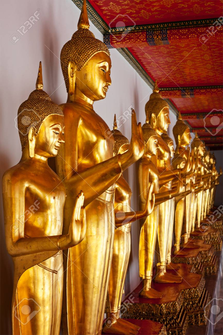 Standing golden Buddha statues close up. Wat Pho temple, Bangkok, Thailand Stock Photo - 22735916