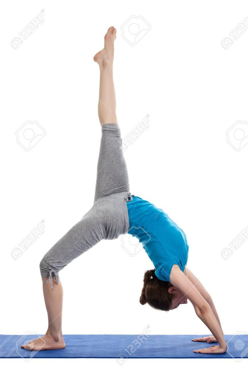 Yoga - young beautiful woman yoga instructor doing Wheel Pose..