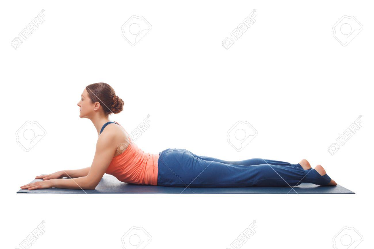 Beautiful sporty fit yogini woman practices yoga asana salamba..