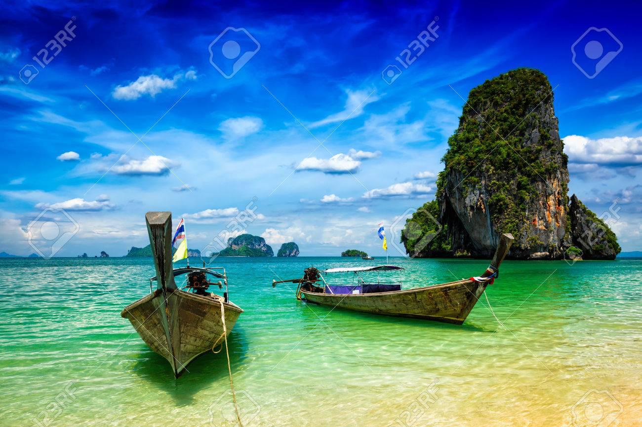 Long tail boats on tropical beach (Pranang beach), Krabi, Thailand - 43578815