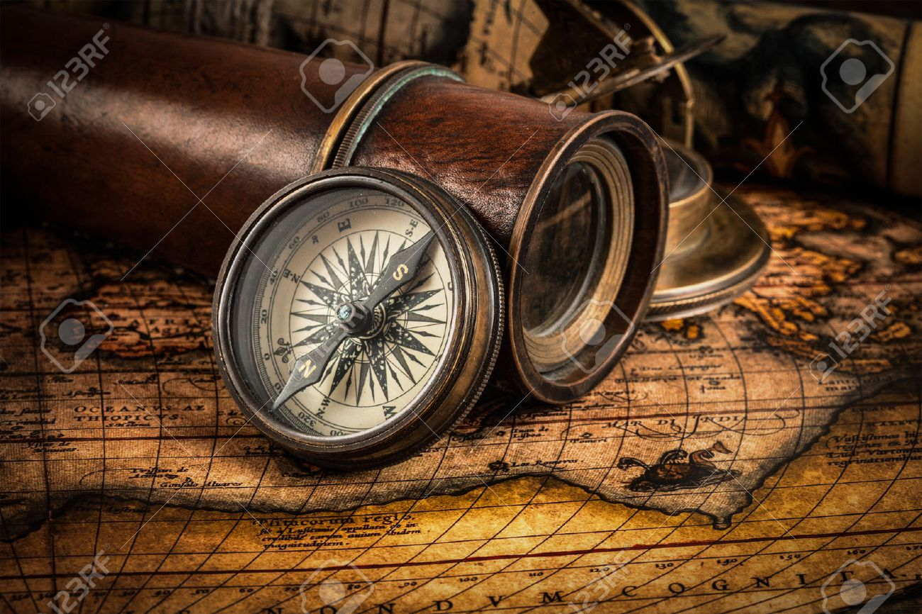 Travel geography navigation concept background - old vintage retro compass with sundial, spyglass and rope on ancient world map - 43579305