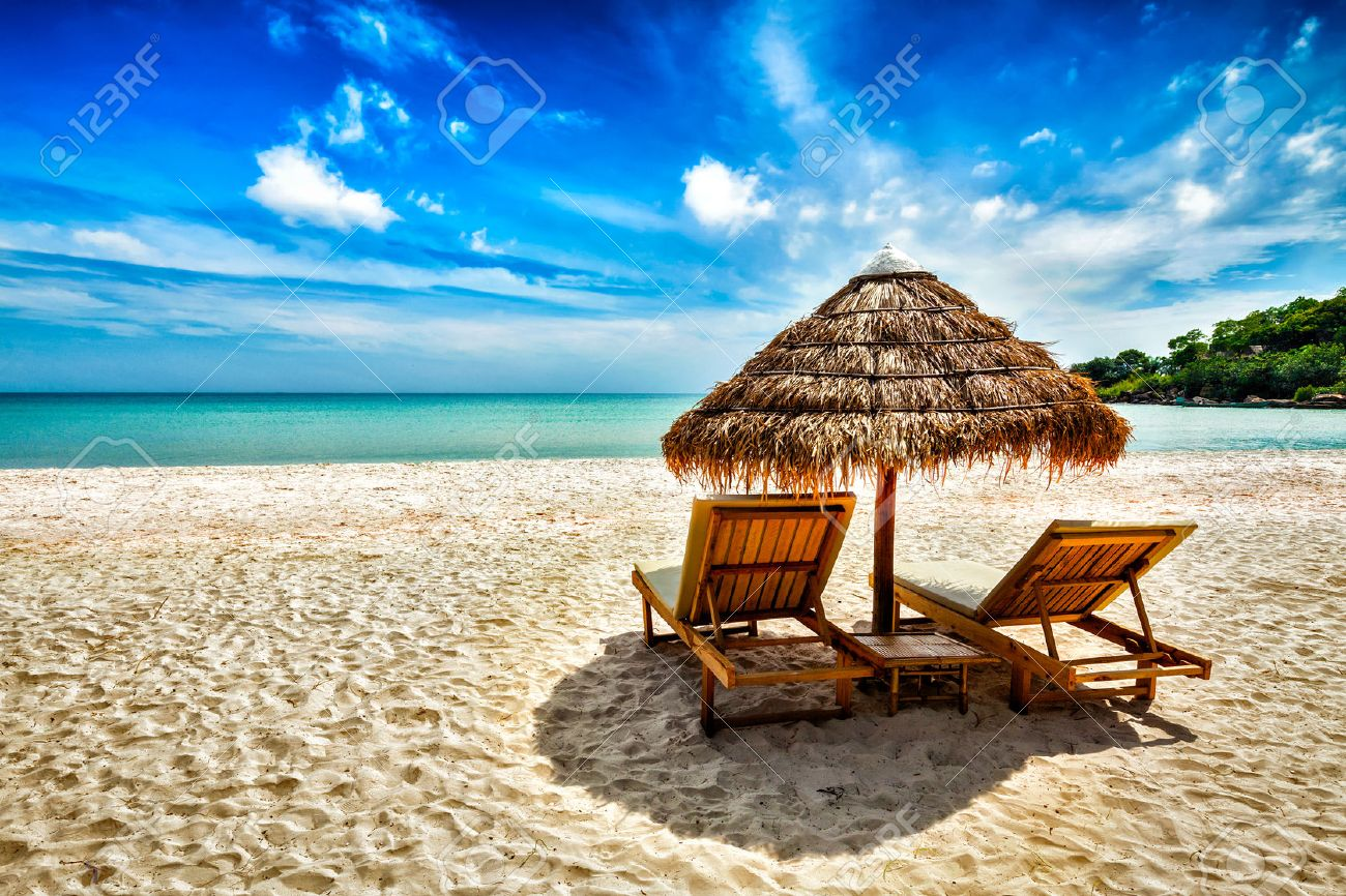 vacation holidays background wallpaper two beach lounge chairs under tent on beach - Beach Lounge Chairs
