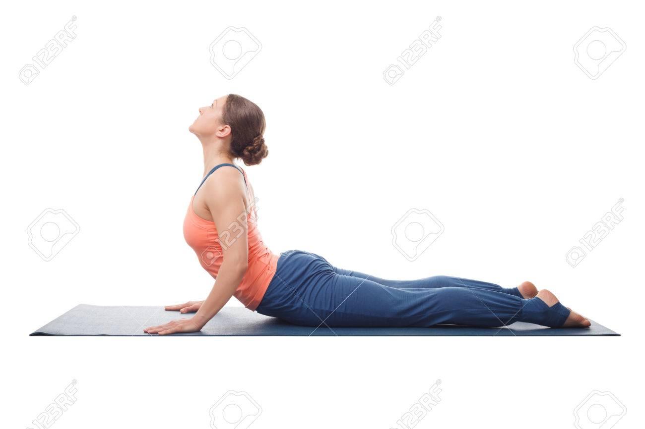 Beautiful sporty fit yogini woman practices yoga asana bhujangasana - cobra pose isolated on white background - 45529852