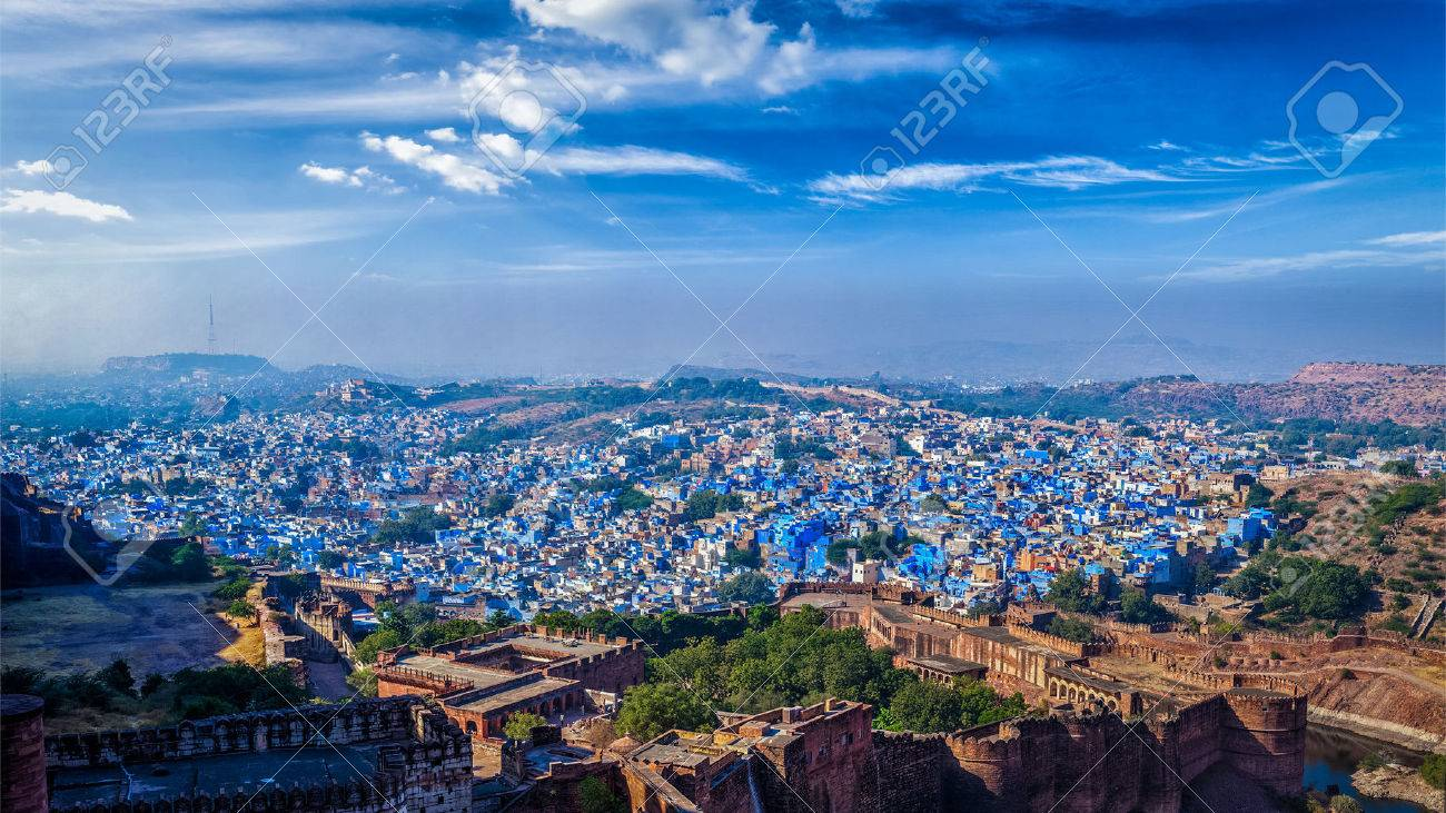 Aerial panorama of Jodhpur, also known as Blue City due to the vivid blue-painted Brahmin houses. View from Mehrangarh Fort (part of fortifications is also visible). Jodphur, Rajasthan, India - 47058108