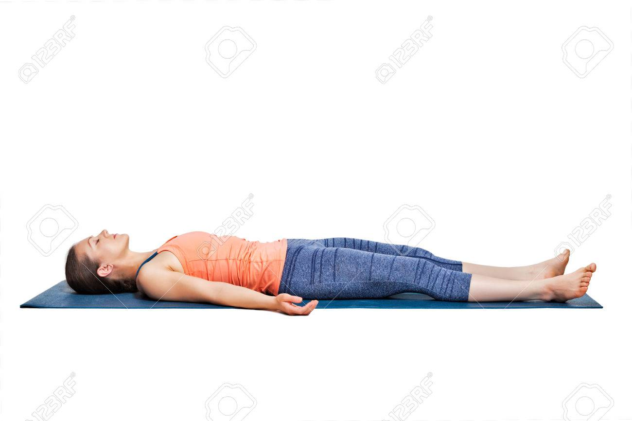 Beautiful sporty fit yogini woman relaxes in yoga asana Savasana - corpse pose in studio - 48366997