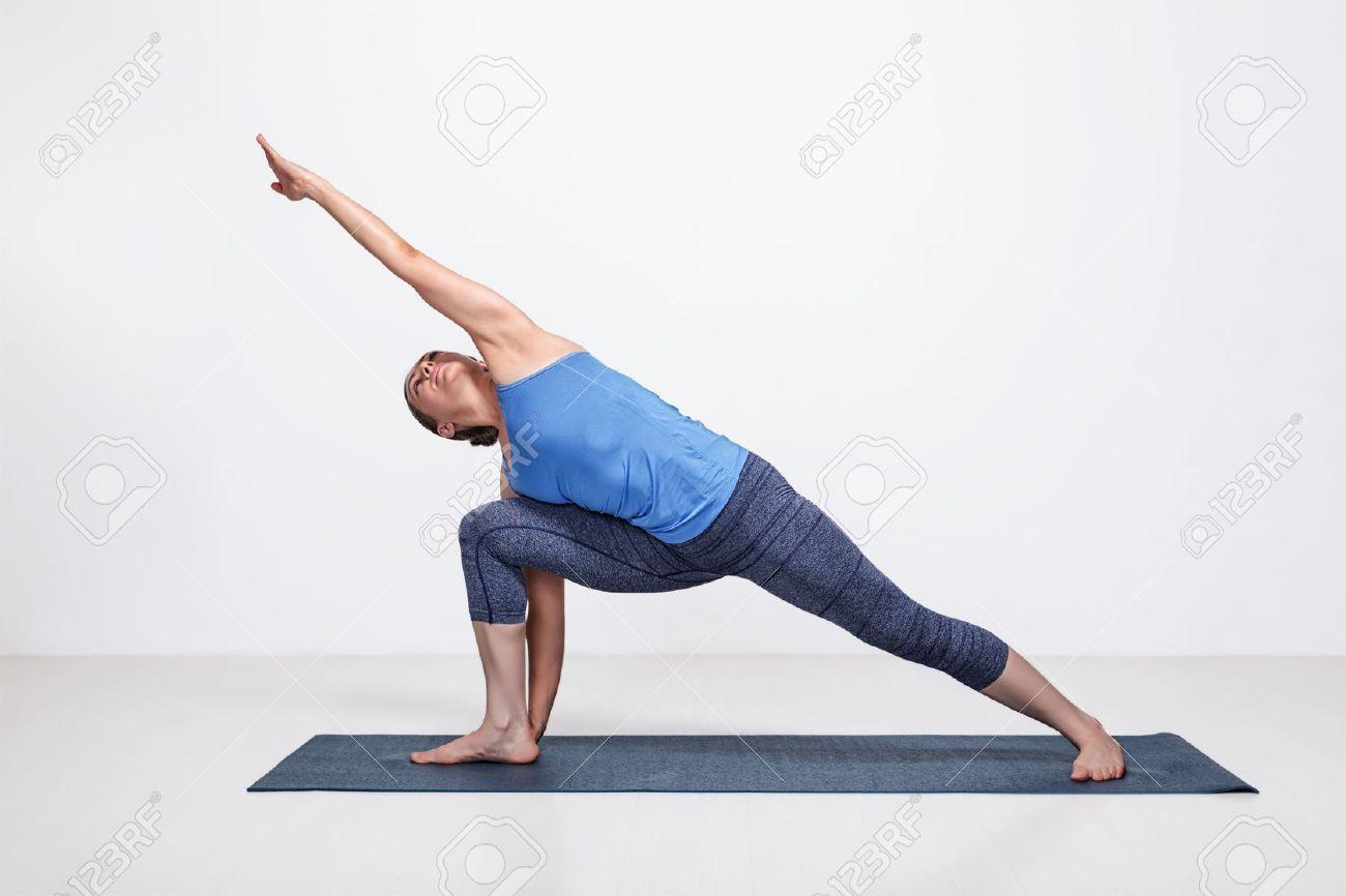 Young Fit Woman Doing Ashtanga Vinyasa Yoga Asana Utthita