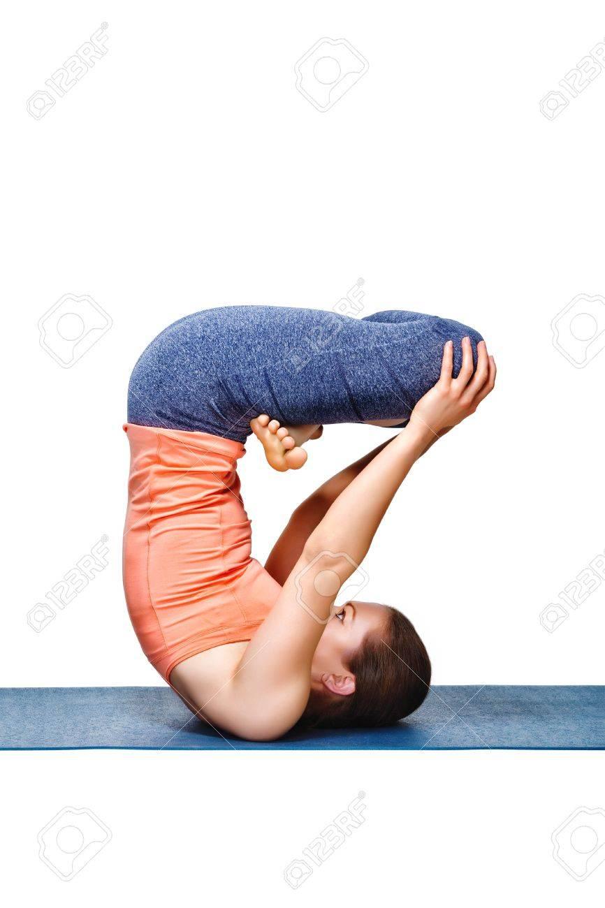 Banque d images - Pratiques sportives femme Yogini ajustement yoga asana  inversé Urdhva padmasana - lotus levé pose isolé sur blanc 956b0fd98e3