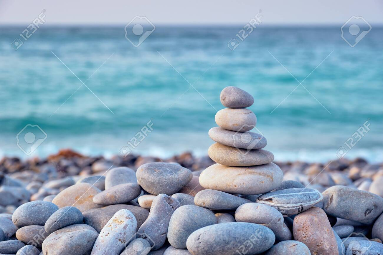 Zen balanced stones stack on beach - 131667012