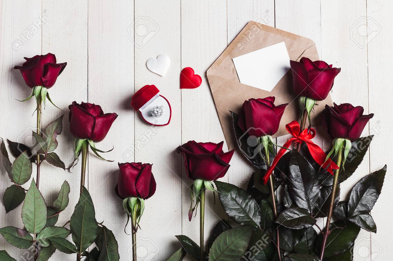 Valentines day envelope love letter with greeting card engagement stock photo valentines day envelope love letter with greeting card engagement ring in box mothers day red rose gift surprise on wooden background with m4hsunfo
