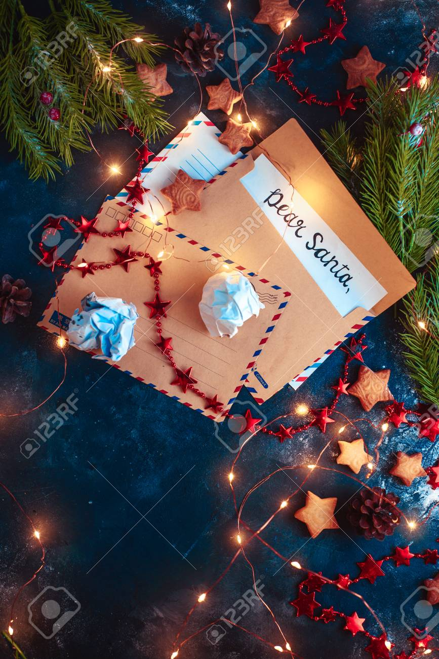 Letters to Santa concept, Christmas flat lay with fairy lights, star-shaped cookies, and tea. Christmas still life from above with contrast colors and copy space - 113245519