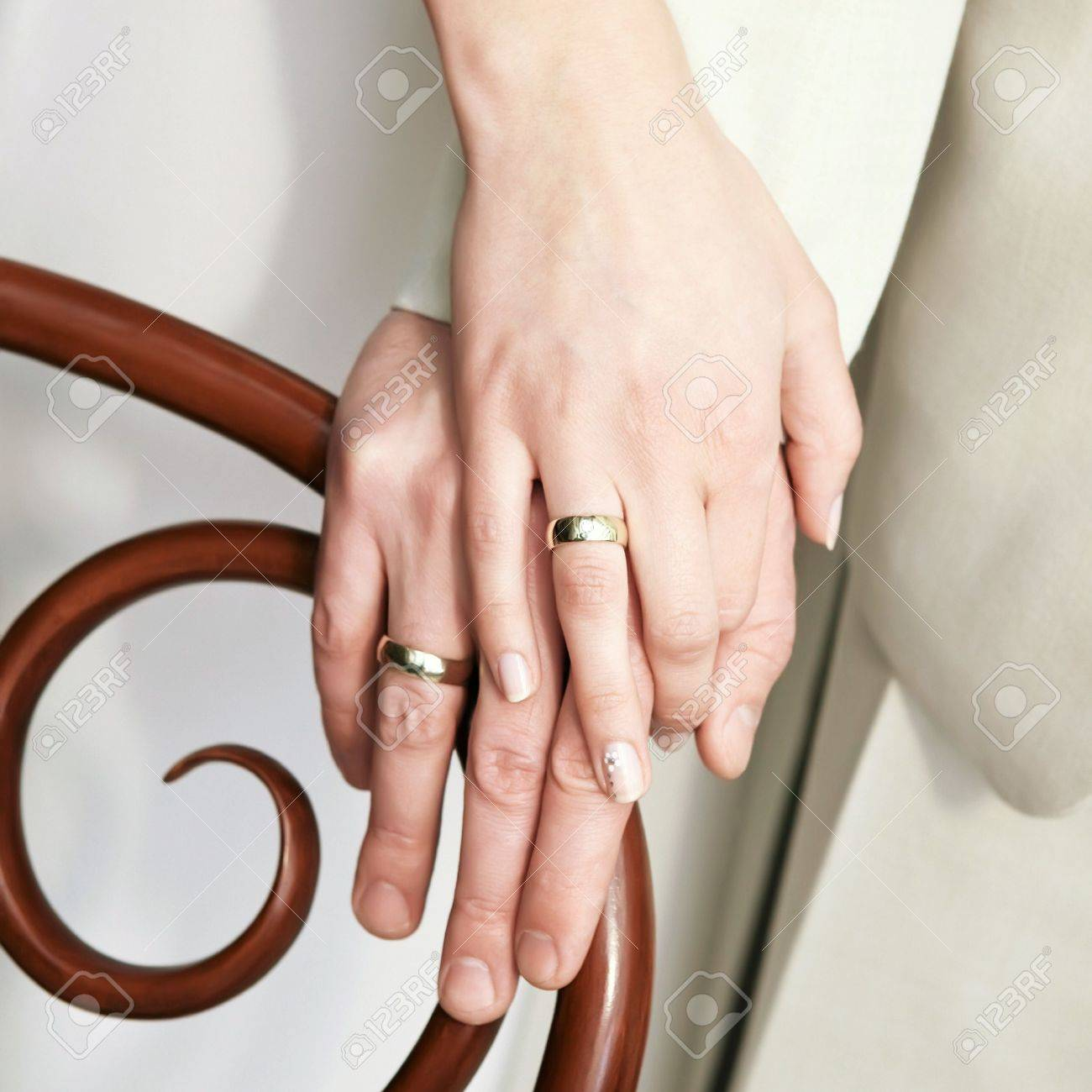 Just married young couple showing up their rings Stock Photo - 7970126