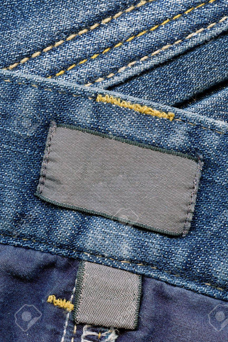 Closeup of blank dark cotton labels inside of blue worn jeans, kind of textured background Stock Photo - 8625558