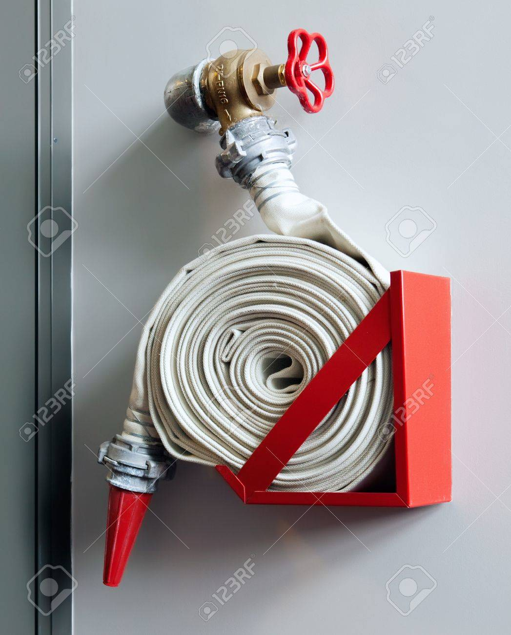 Fire-hose on the wall in a modern building Stock Photo - 10103692