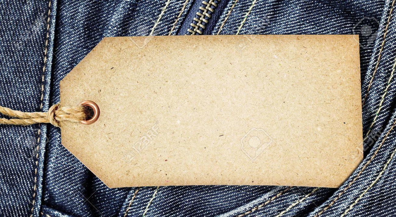 Vintage paper tag on blue denim Stock Photo - 10529474