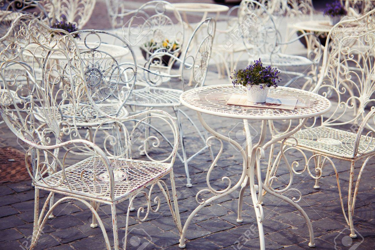 Lavender On The White Metal Table And Ornate Chairs In Provence Style  Street Cafe Stock Photo