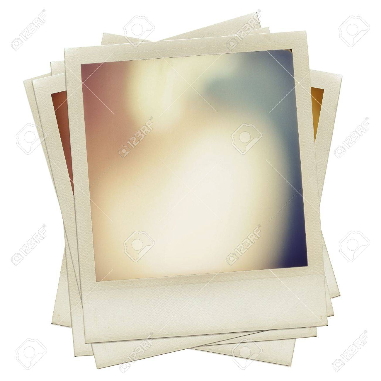 a pile of grungy blank instant film frame with abstract color filling isolated over white