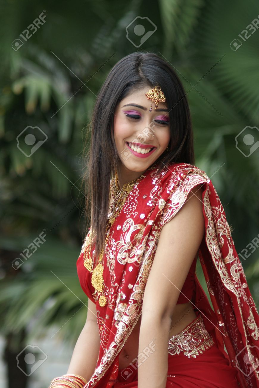 young indian girl in red traditional saree clothing stock photo