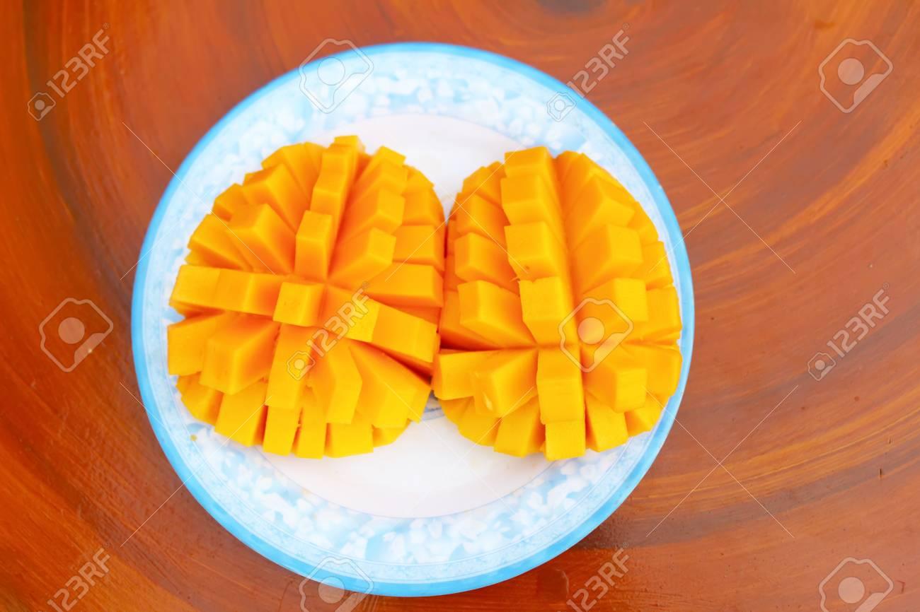 Mango slice cut to cubes close-up - 41664344