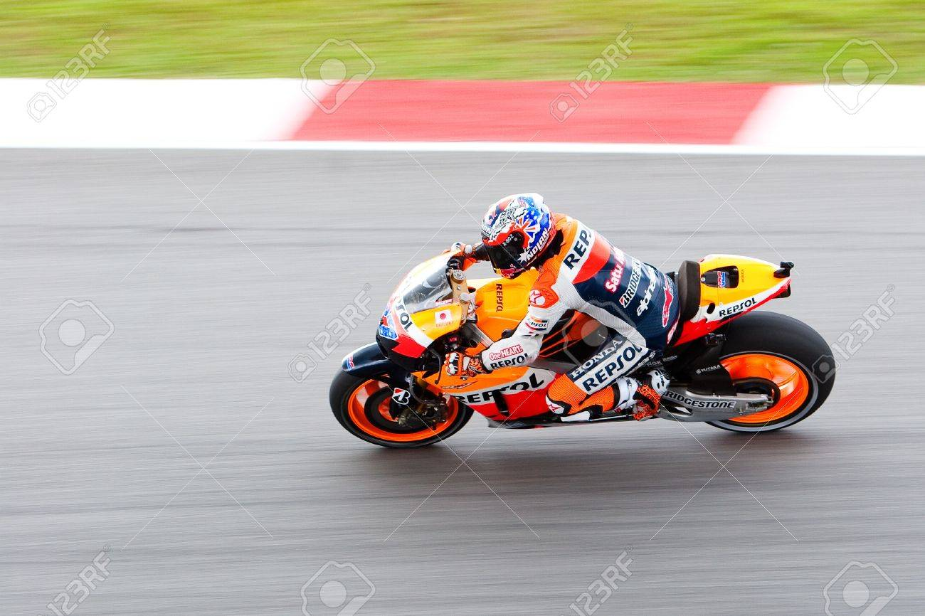 SEPANG, MALAYSIA-OCT 21: Respol Honda MotoGP rider Casey Stoner from Spain takes a corner during a free practice session at Sepang International Circuit on October 21, 2011 Sepang Malaysia . The Malaysian Motorcycle Grand Prix will take place on Oct 23 Stock Photo - 11063875