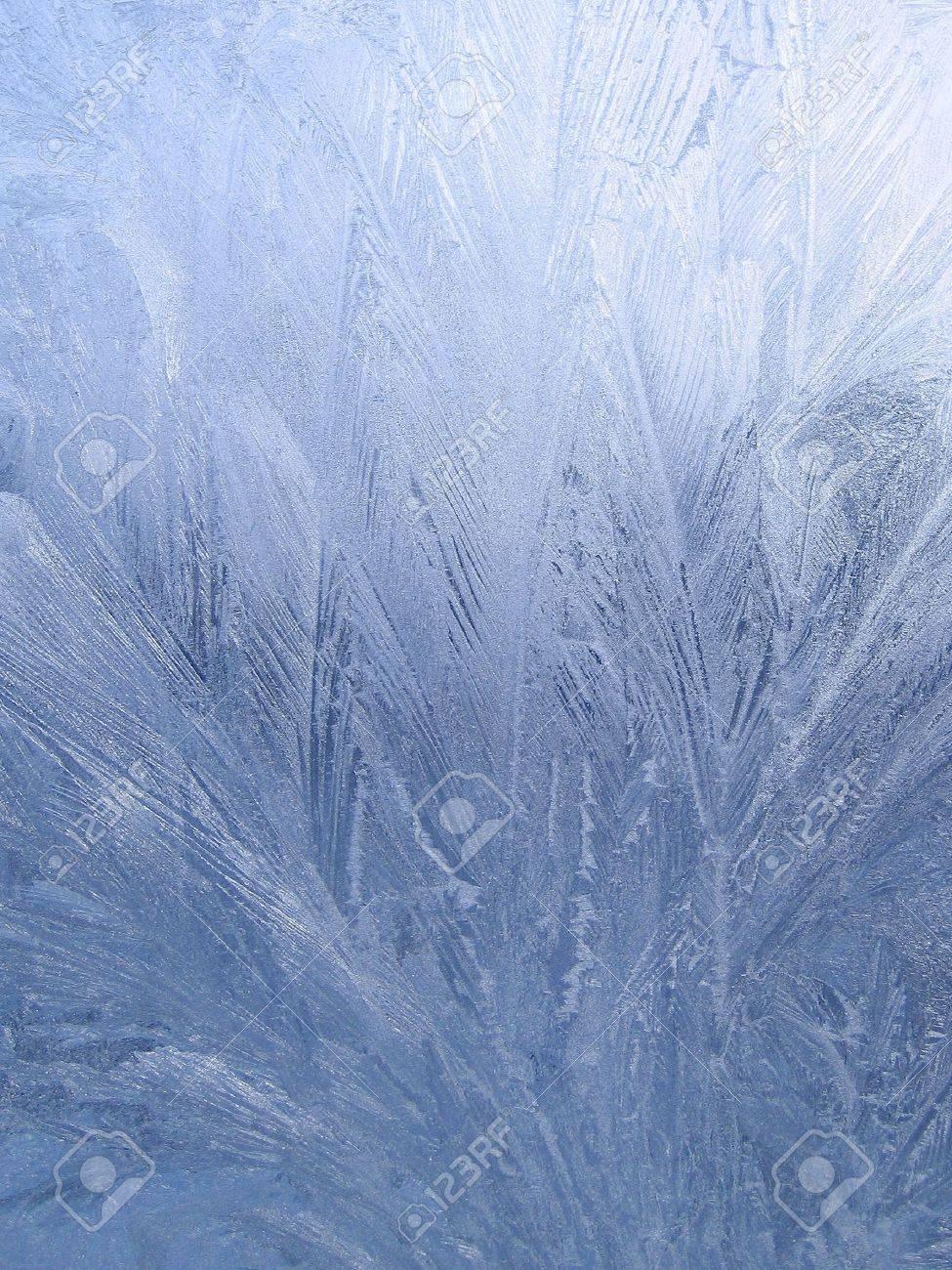 blue frosty natural pattern on winter window - 7757327